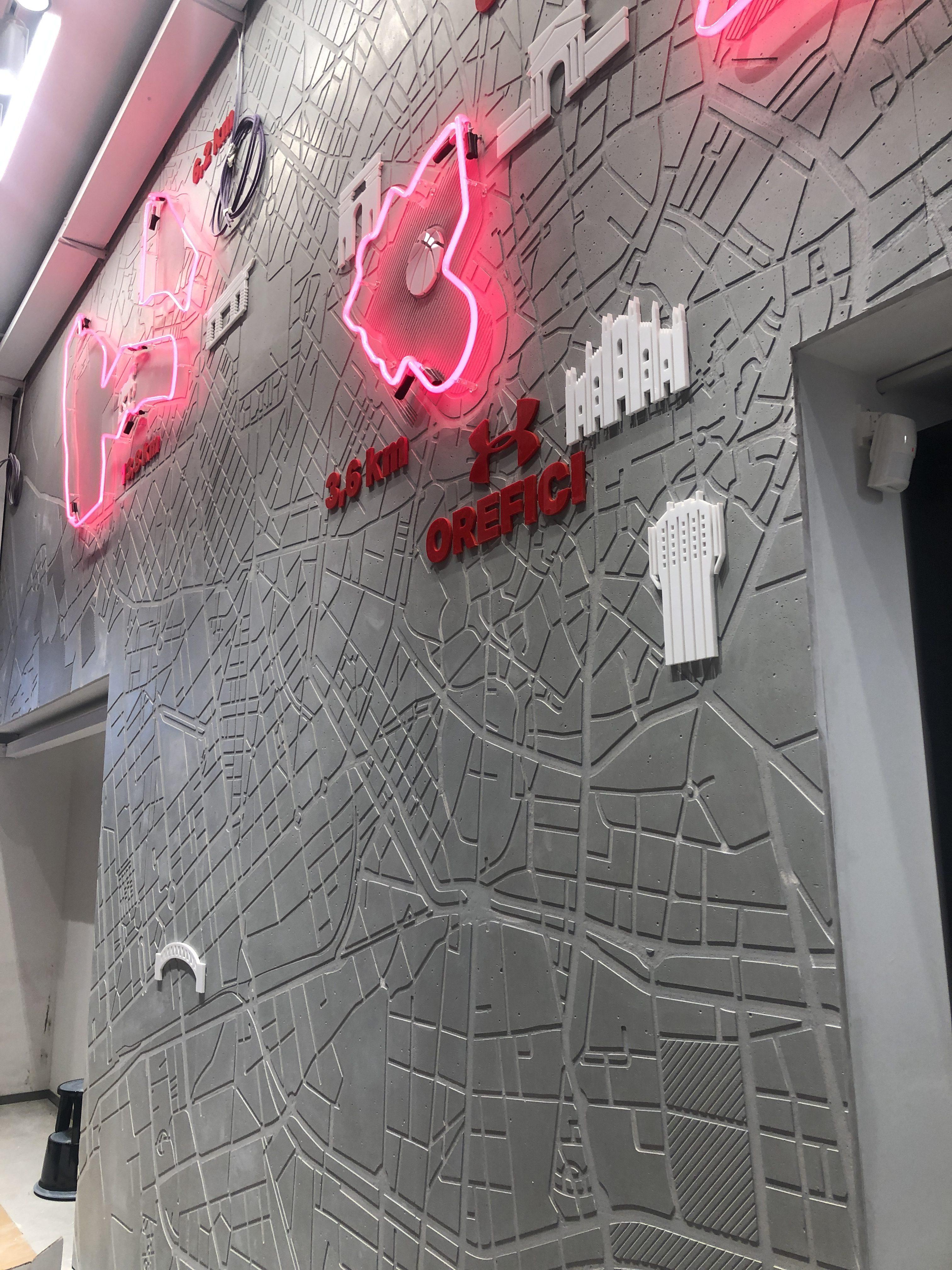 Under Armour_ Sopa Design Studio _ pareti rivestite in Conclad, il cemento non cemento a pannelli